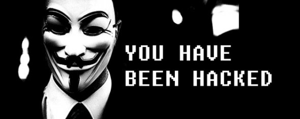 Man wearing Guyfawkes mask with the text 'You Have Been Hacked'